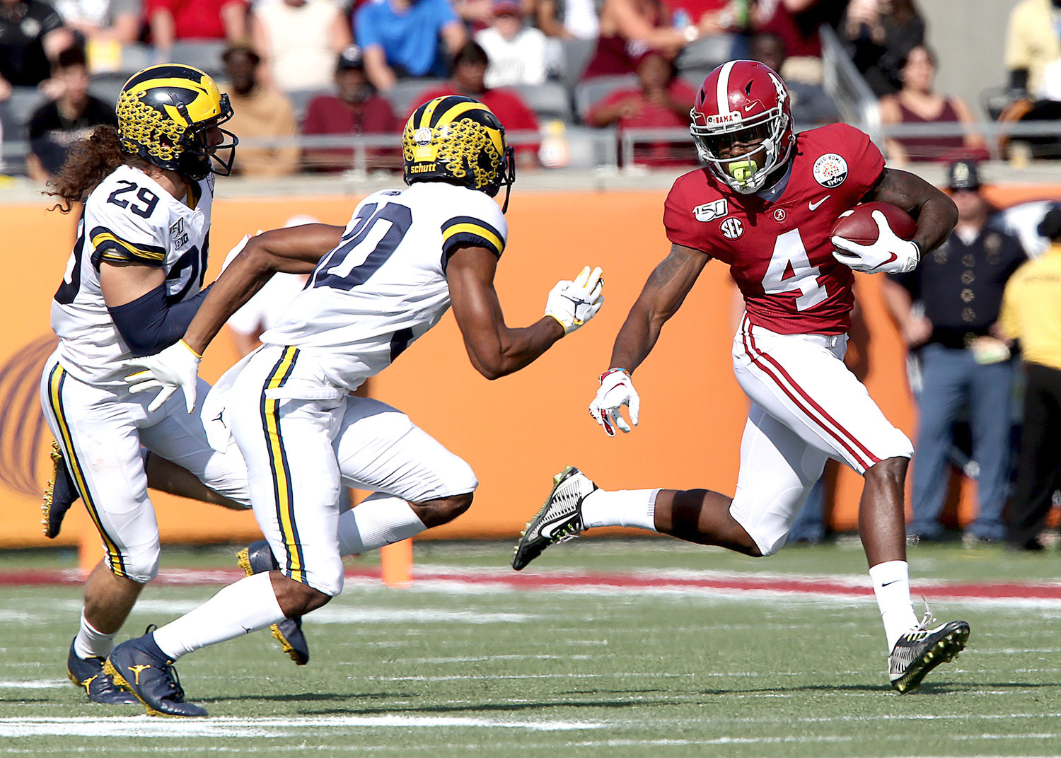 Alabama Crimson Tide wide receiver Jerry Jeudy (4) tries to find the edge during the first half of the Citrus Bowl against the Michigan Wolverines Wednesday at Camping World Stadium in Orlando, Fla. Alabama won 35-16.