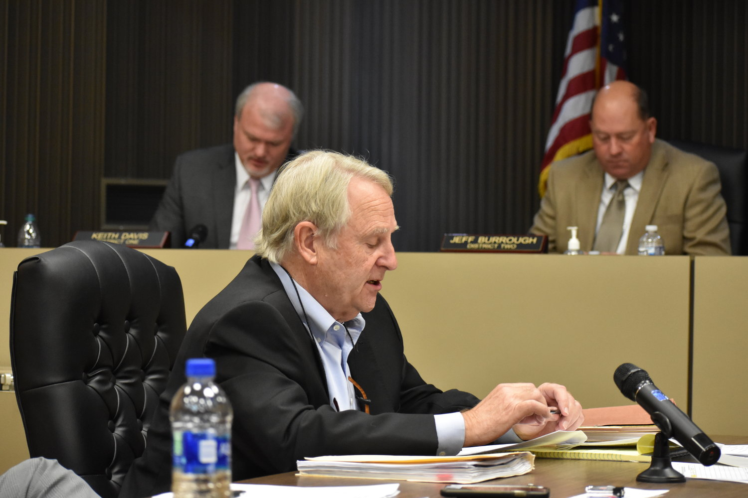 Eddie Jackson, the county attorney for the Walker County Commission, reads a letter at Monday''s meeting detailing how Republic Services will close the Pineview Landfill in 2025. Commissioners Keith Davis, left, and Jeff Burrough follow along.