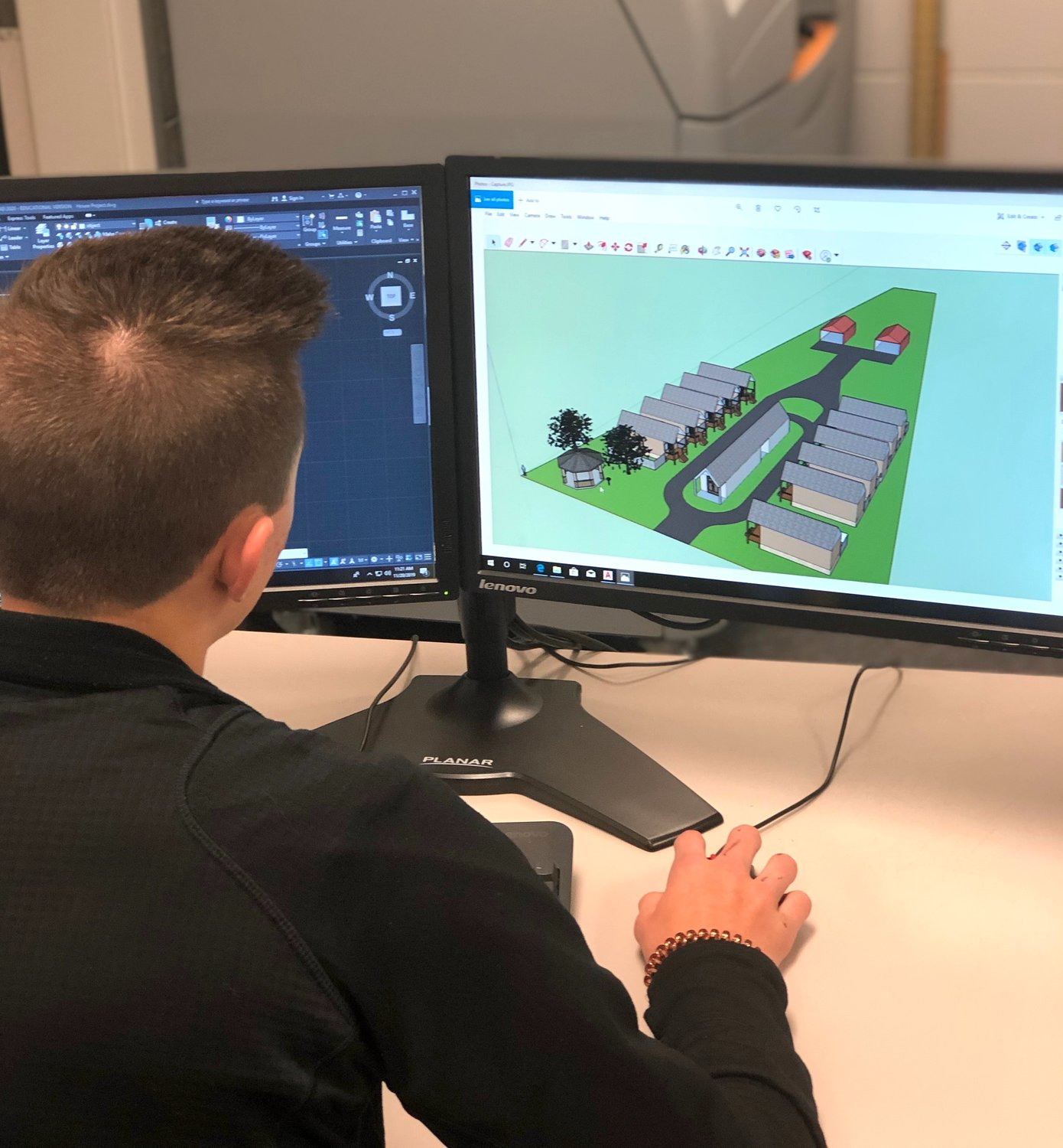 A Bevill State Community College engineering student works to design a 3D model for a proposed tiny home village for veterans.