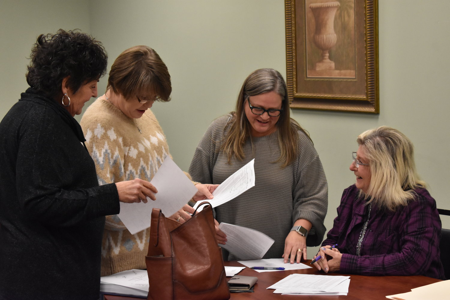 Carbon Hill city officials, after a tough meeting of looking at finances, finally share a light-hearted moment after Monday's council meeting. Talking are, from left, Councilwomen Jewell Hess and April Herron, City Clerk Sherry Garner and Assistant Clerk  Janice Pendley.