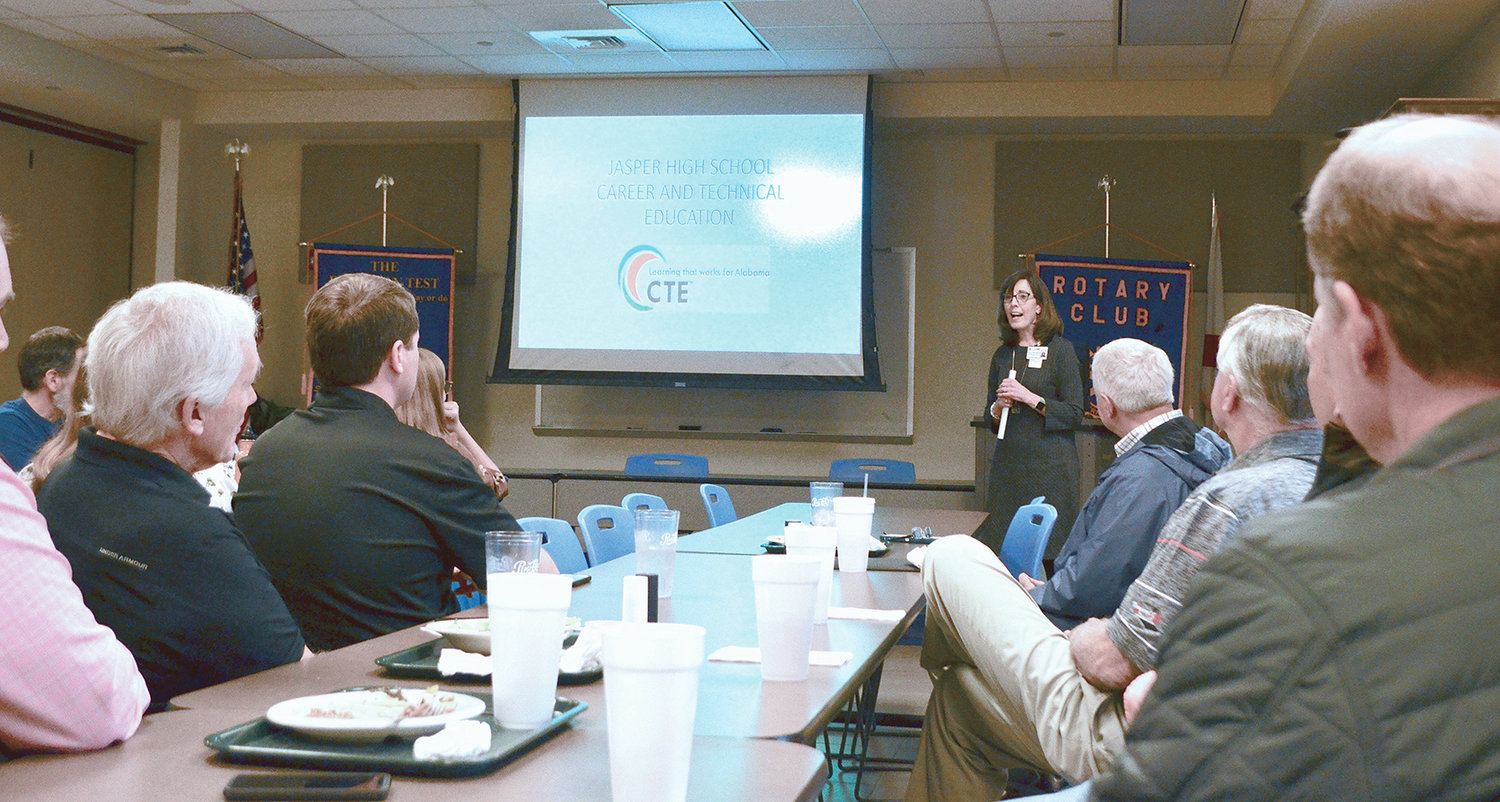 Beth Kennedy, back right, spoke to Rotarians on Tuesday about career tech programs at Jasper High School.