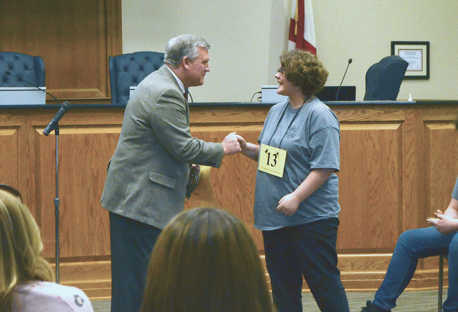 Valley Jr. High School student Annaleigh Tubbs is congratulated by Walker County Schools Superintendent Dr. Joel Hagood for winning the Walker County District Spelling Bee.