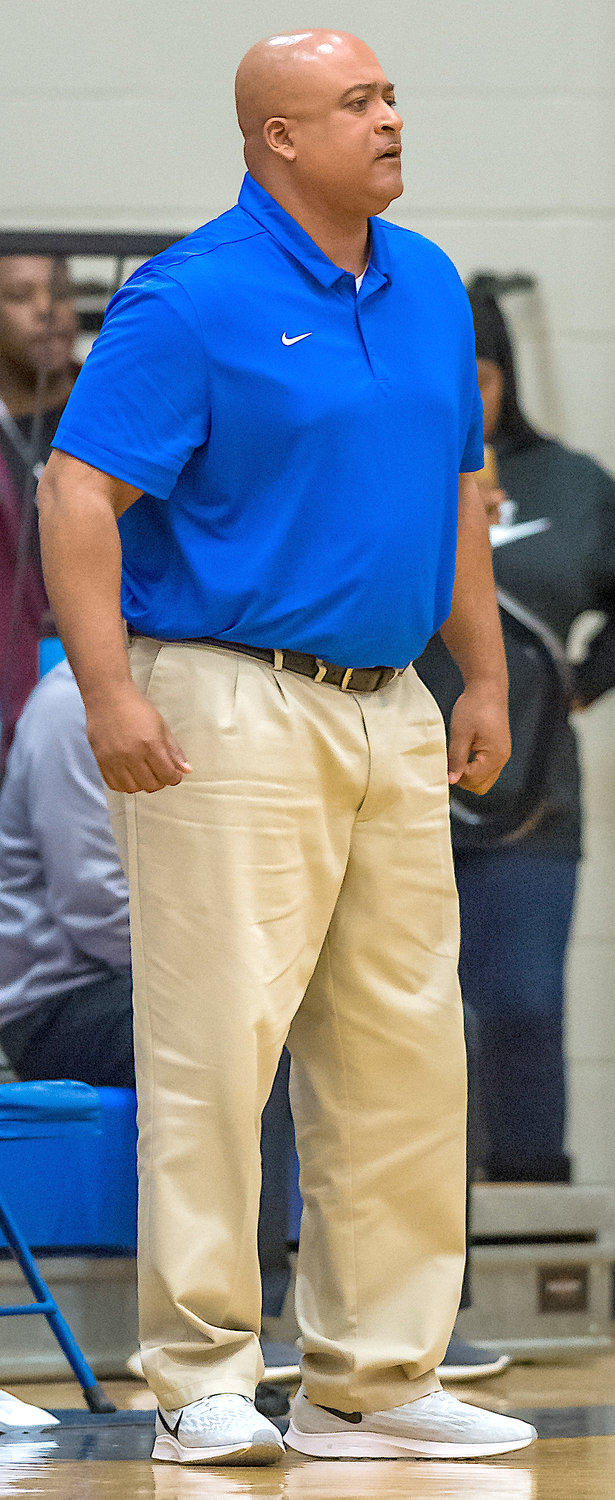 Oakman coach Derek Roberts directs his team during Saturday's Walker County Tournament championship game.