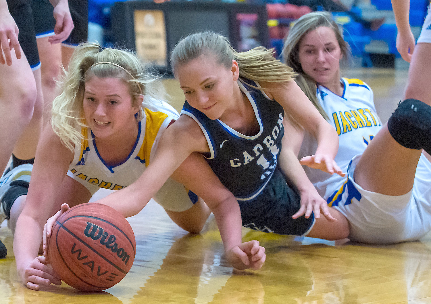 Carbon Hill's Alayna Ivie (11) and Curry's Abbey Moon battle for a loose ball during Saturday's game.