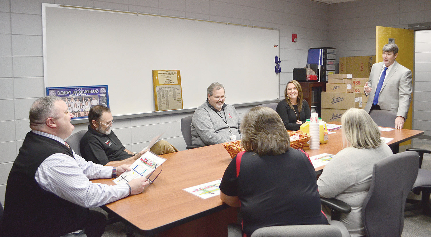 Carbon Hill High School Assistant Principal Chris Harris, standing, discusses a new wayfinding effort at the school to help first responders.