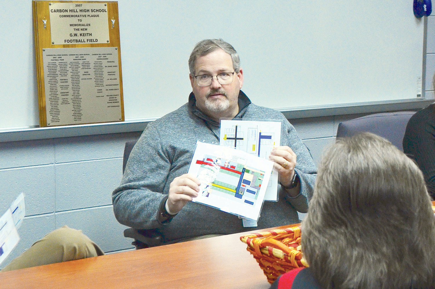 Carbon Hill Elementary/Jr. High Principal Dr. Jami Rainey shows a map to representatives with Walker County E-911 that demonstrates how color coding is being used for emergency navigation in the school building.