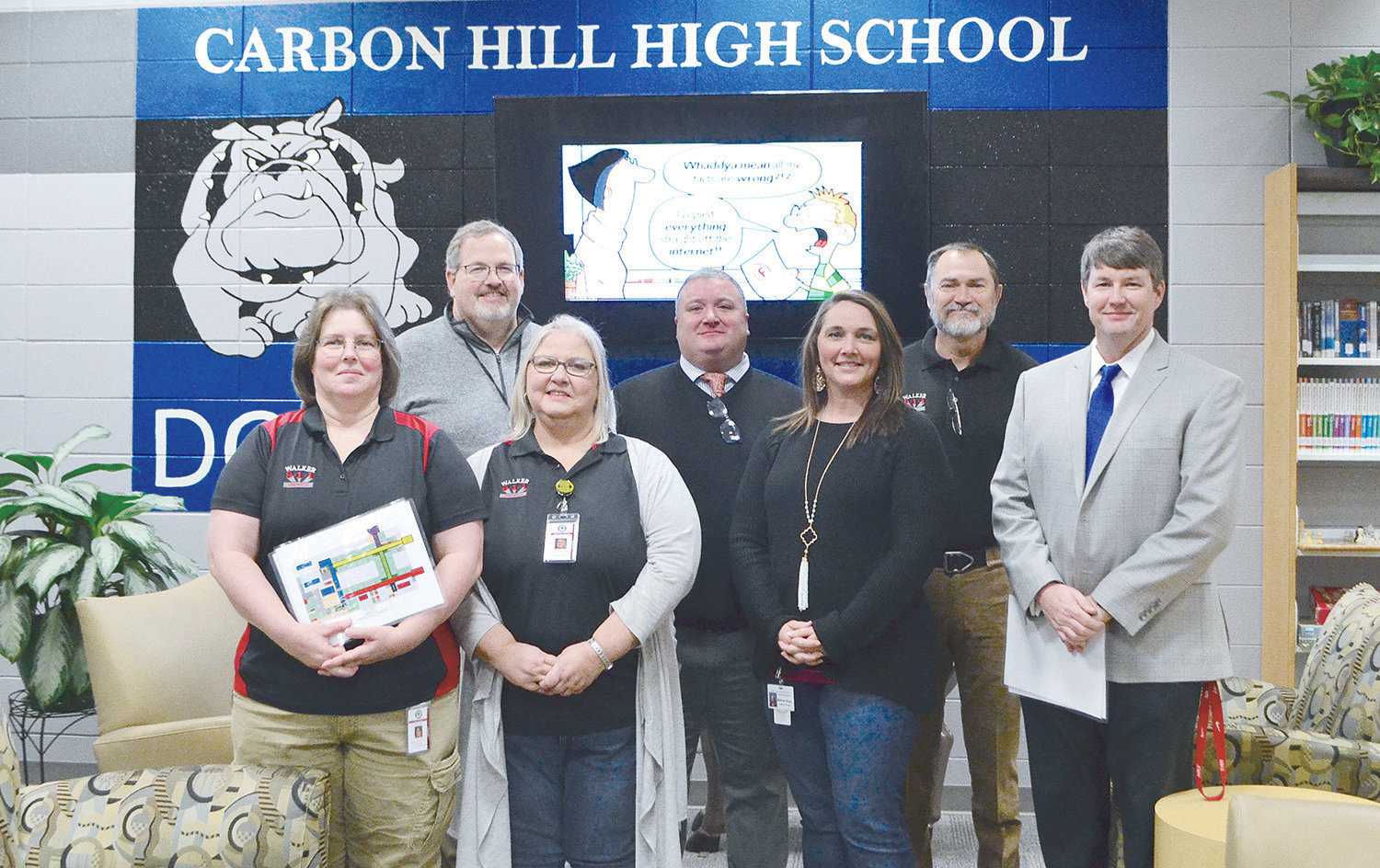 A new emergency response plan was unveiled at Carbon Hill schools last week. Pictured, from left to right, back row, is Carbon Hill Elementary/Jr. High Principal Dr. Jami Rainey, Carbon Hill High Principal Kyle Dutton and Walker County E-911 Executive Director Tim Thomas. Front row, from left to right, is Walker County E-911 employees Crystal Hill and Sherrea Chamness, Carbon Hill Elementary/Jr. High Assistant Principal Melinda Boots and Carbon Hill High School Assistant Principal Chris Harris.