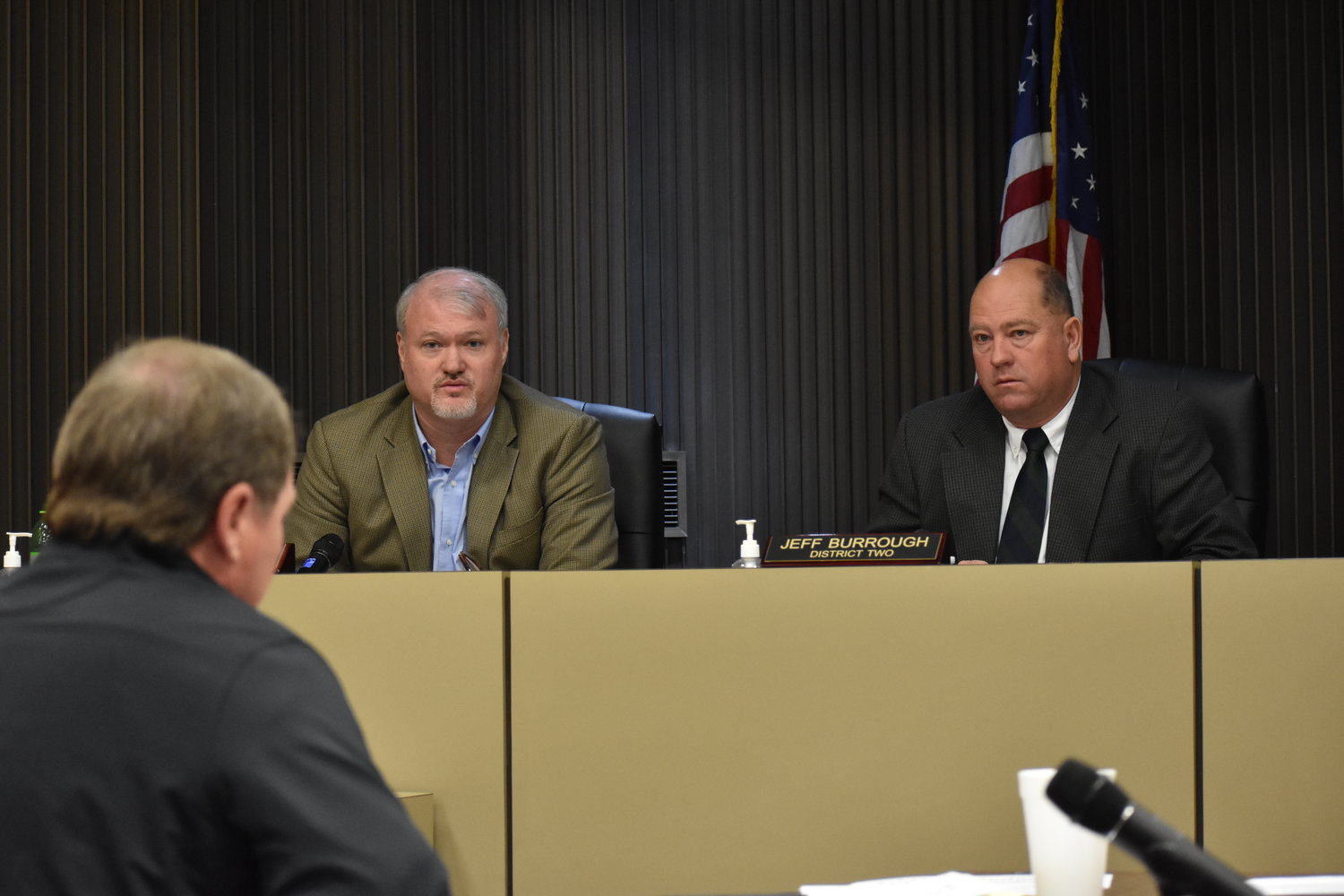 Commissioners Keith Davis, left, talks to County Engineer Mike Short, while Commissioner Jeff Burrough listens, during Monday's Walker County Commission meeting.