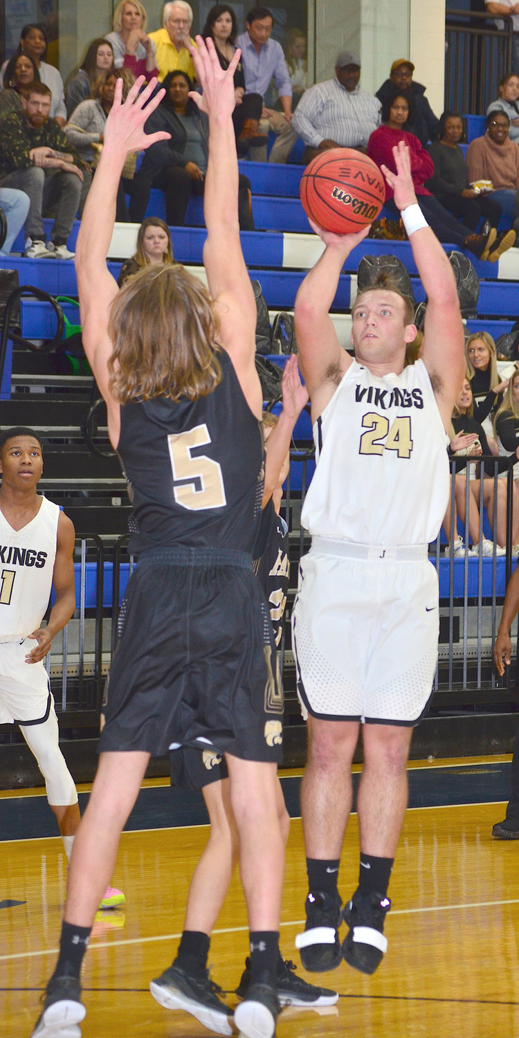 Jasper's Harrison Saunders (24) shoots over Hayden's Brandon Blakely (5) during their Class 5A, Area 11 Tournament game at Mortimer Jordan on Tuesday. The Vikings won 70-47. Jasper plays Mortimer Jordan for the area tournament championship at 7 p.m. Thursday.