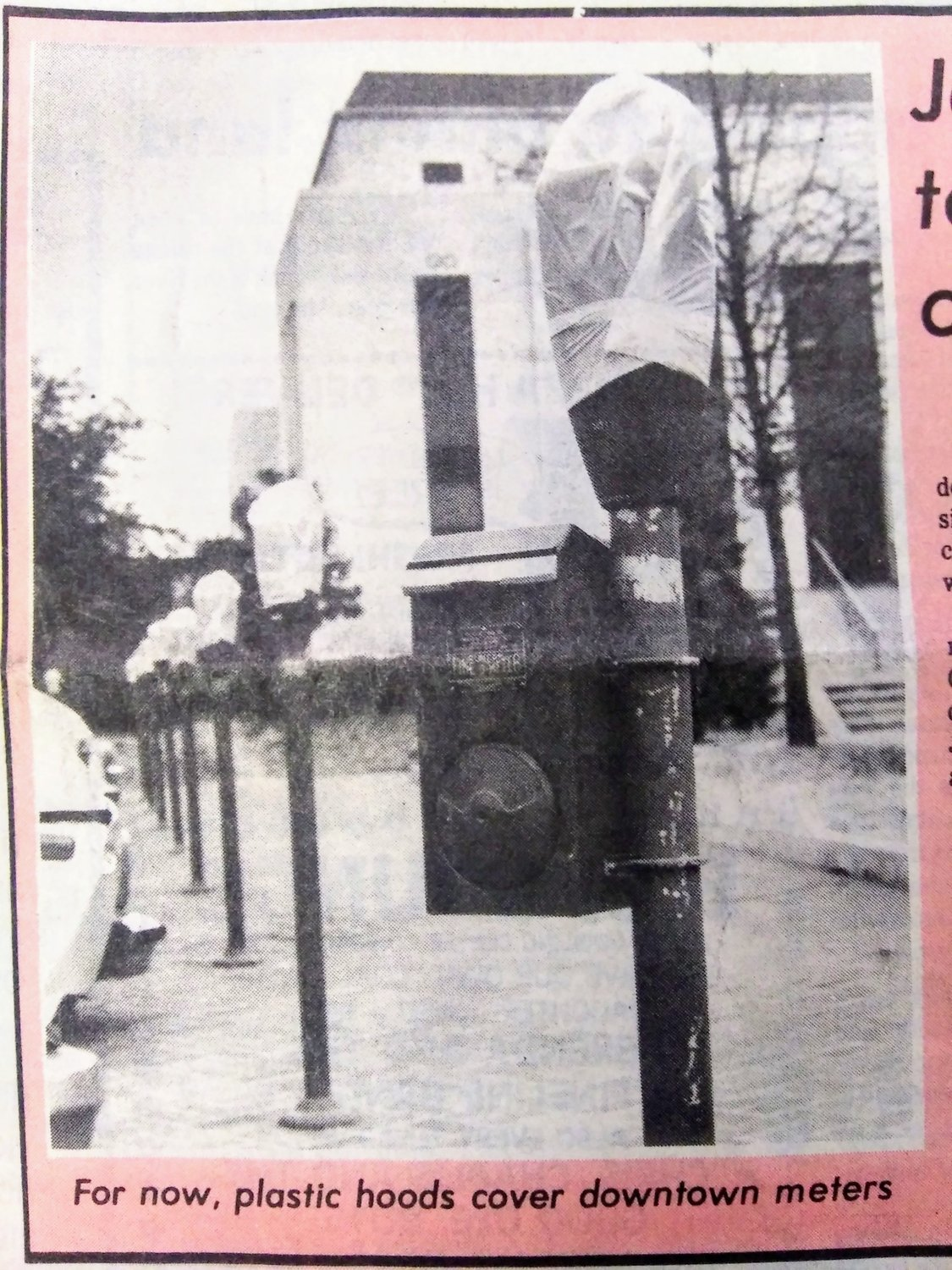 Downtown parking meters were covered during the 1985 Christmas shopping season.