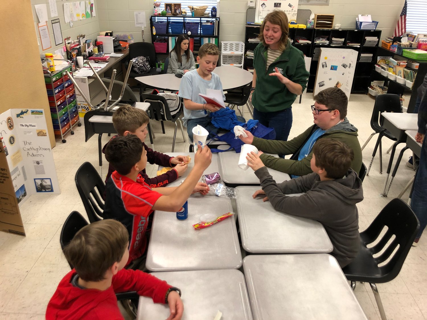 Hannah Borgerson, the lead instructor and outreach director for Camp McDowell, oversees an activity with Meek students. Camp McDowell instructors have taught a recycling curriculum in Meek schools for two years.