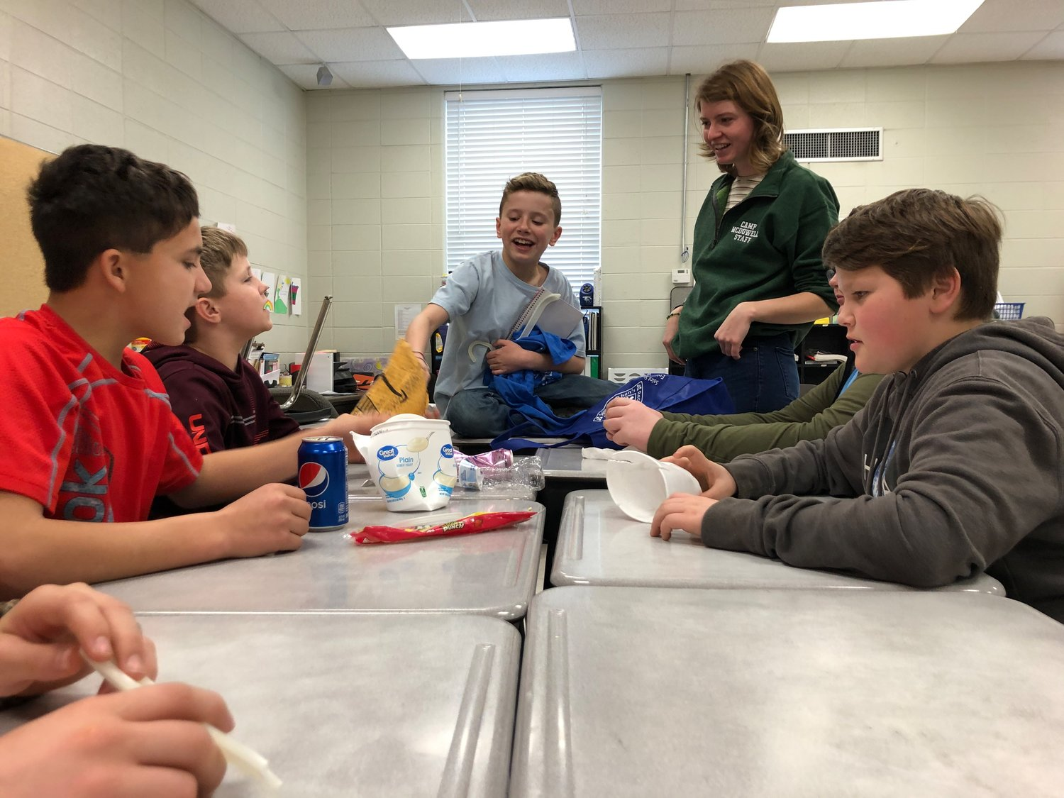 Hannah Borgerson talks to Meek students during an activity. Instructors from Camp McDowell presented a new recycling curriculum during the final two weeks of January to all Meek students.