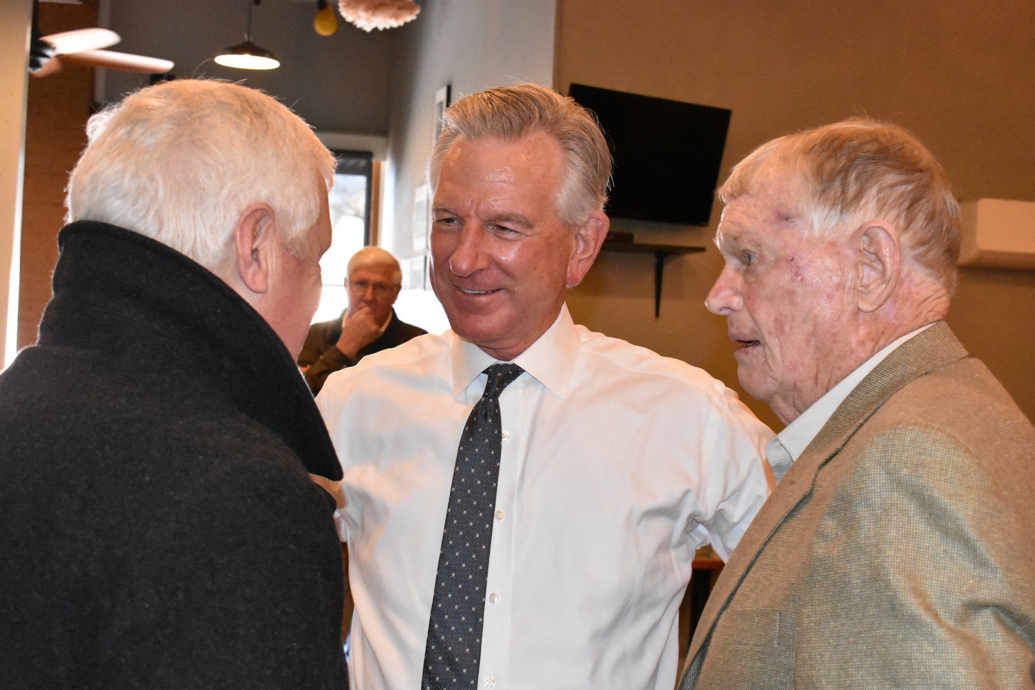 Republican Senate candidate Tommy Tuberville, center, talks with Jasper Mayor David O'Mary, left, and retired Jasper dentist Buddy Thorne Friday. Tuberville was in Jasper to speak at a campaign luncheon.