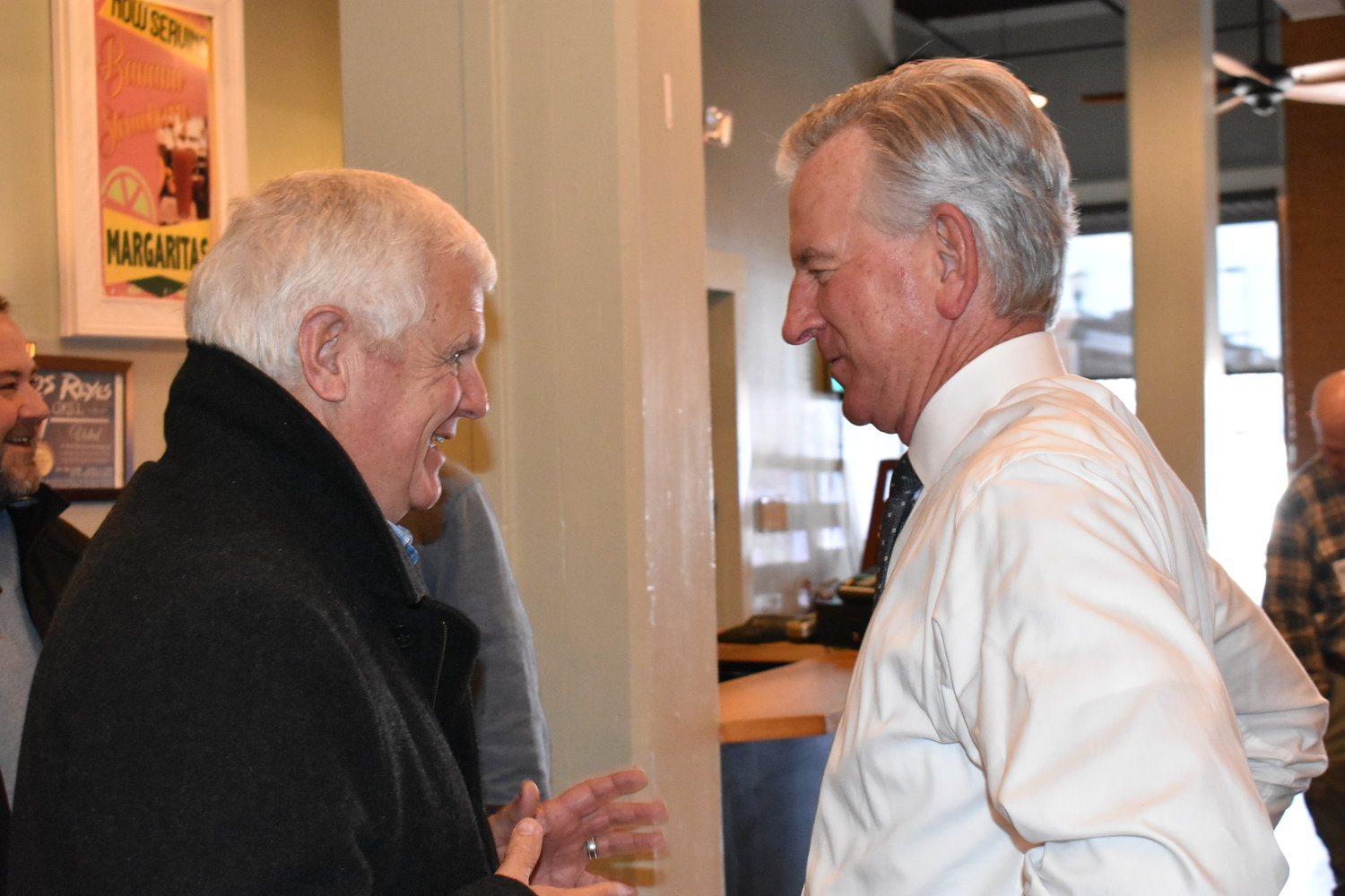 Republican Senate candidate Tommy Tuberville, center, talks with Jasper Mayor David O'Mary, left, Friday. Tuberville was in Jasper to speak at a campaign luncheon.