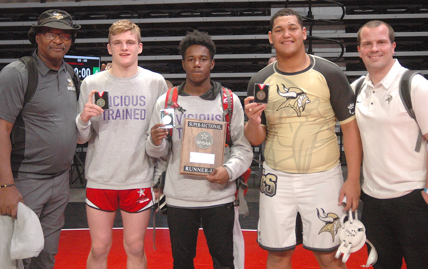Three Jasper High School wrestlers won North Super Section titles on Saturday at the Birmingham Crossplex's Bill Harris Arena. Pictured from left, Jasper assistant coach Hezzie Morgan, Preston Reed (152 pounds), Maney Havis (145 pounds), Brodie Vinson (285 pounds) and head coach Tripp Otis. All three Jasper wrestlers will compete in the State Wrestling Tournament next week in Huntsville.