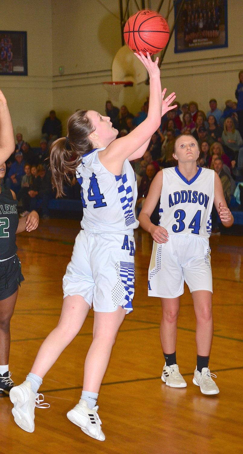Addison's Kaylee Brummett (14) shoots as teammate Callie Crider (34) looks on during Monday's game.