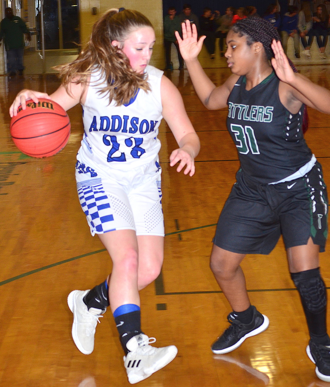 Addison's Gracie Manley (24) is defended by Tanner's Samauri Townsend (31) on Monday.