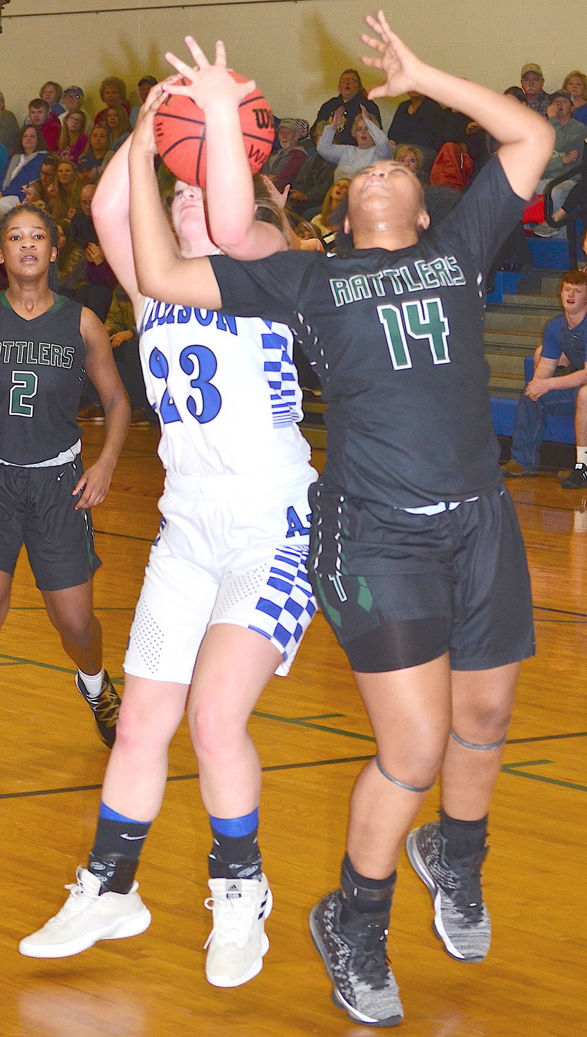 Addison's Gracie Manley (23) battles Tanner's Shauna Fletcher (14) for a rebounds during their Class 2A sub-region matchup on Monday. Tanner eliminated the Bulldogs with a 77-58 victory.