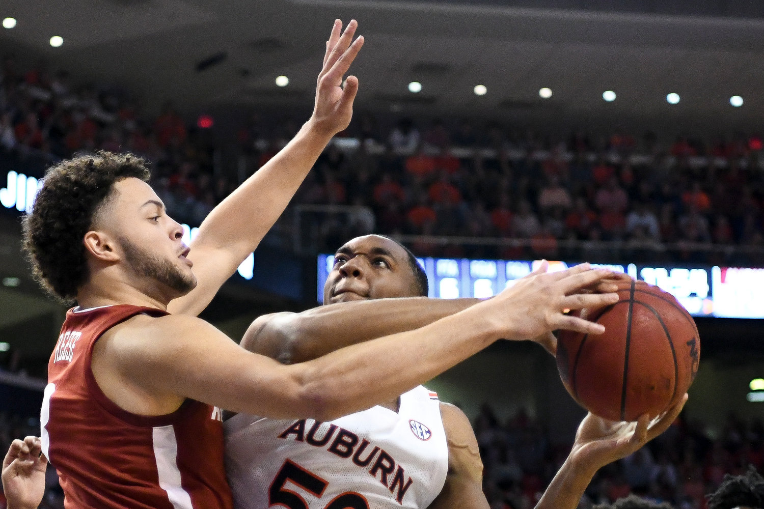 Auburn center Austin Wiley (50) shoots over Alabama forward Alex Reese (3) during their game Wednesday at Auburn Arena. Wiley had 18 points, 17 rebounds and five blocks in Auburn's 95-91 overtime win.