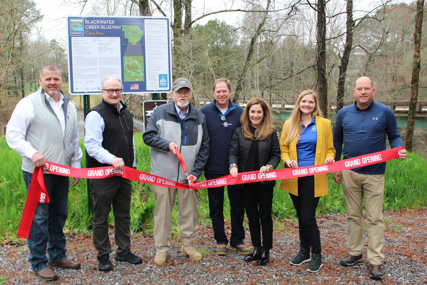 A number of officials celebrated the opening of the Curry Highway Blackwater Creek access point on Thursday. They included, from left, Steven Aderholt, Paul Kennedy, Jerry Bishop, Mike and Jenny Short, Elyse Peters and Jeff Burrough.