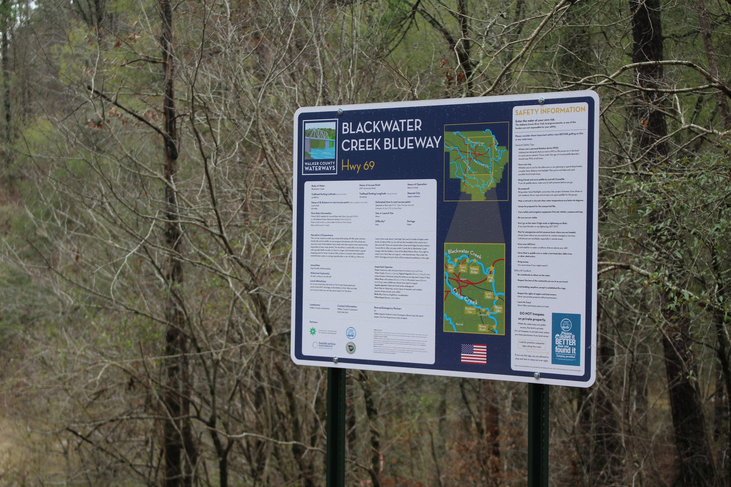 New signage at the Highway 69 access point gives information about the Walker County Waterways Project.