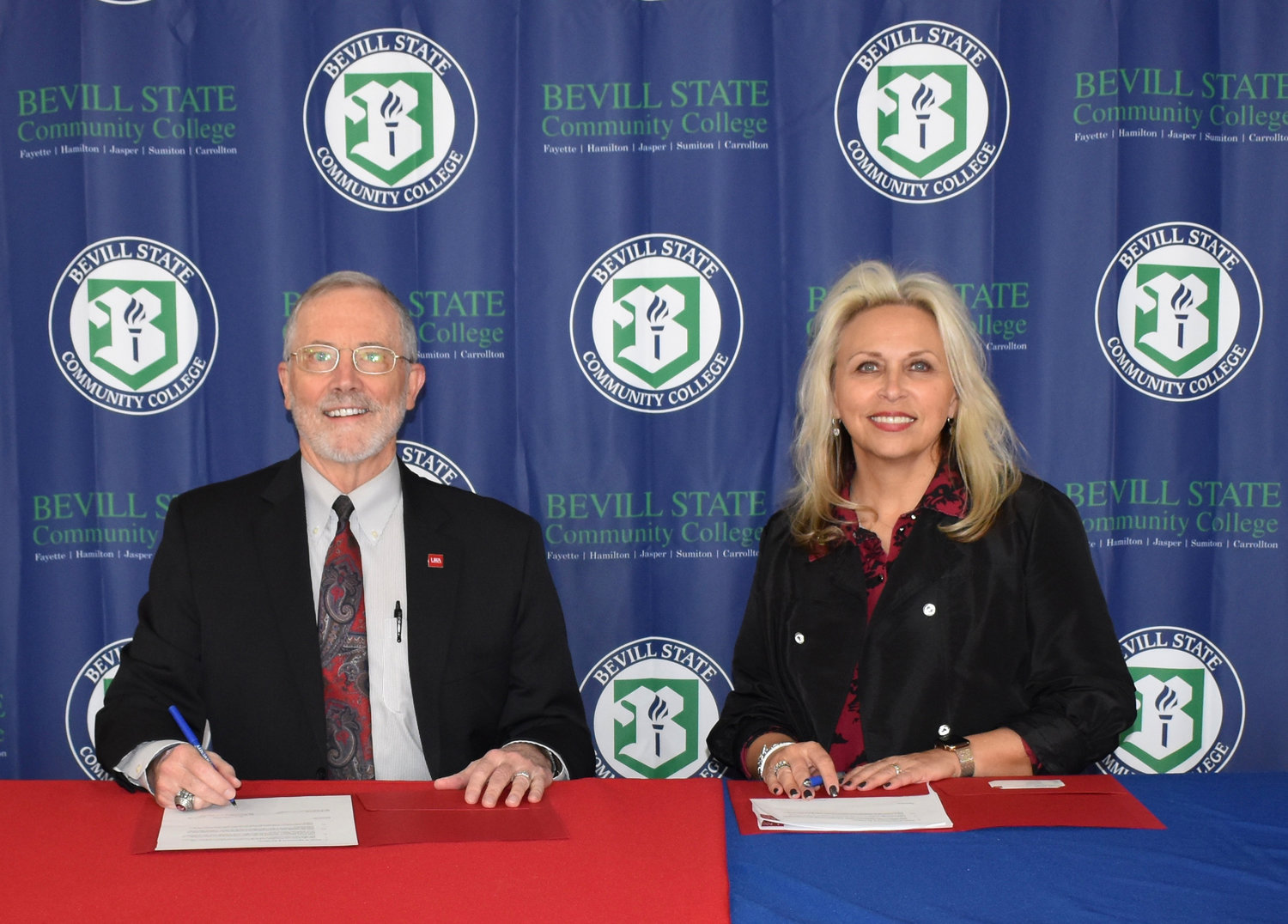 An agreement was recently signed between Bevill State Community College and the University of West Alabama. Pictured, from left to right, is Dr. Ken Tucker, president of UWA, and BSCC President Dr. Kim Ennis.