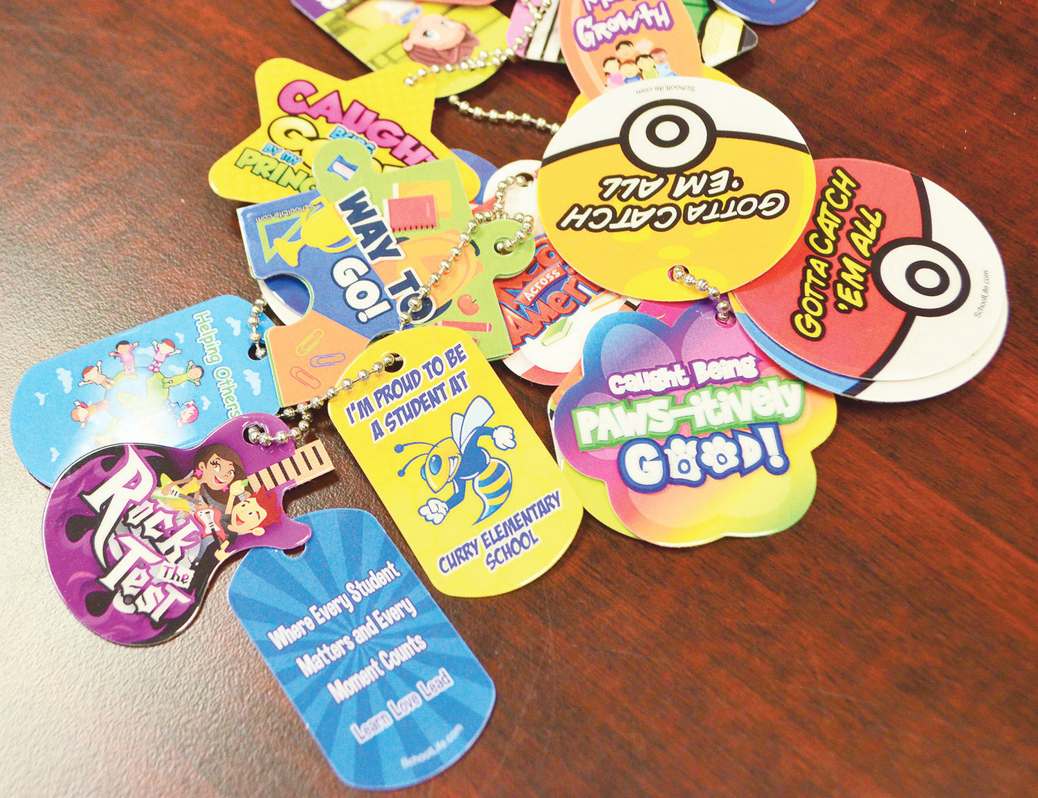 Some of the brag tags that students can receive are pictured.
