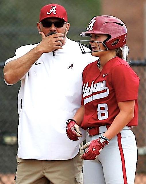 Alabama's KB Sides talks to head coach Patrick Murphy during a game this season. Sides lead the Tide with a .429 batting average and 19 RBIs. The ninth-ranked Tide opens SEC play with a home series against No. 20 Arkansas this weekend.