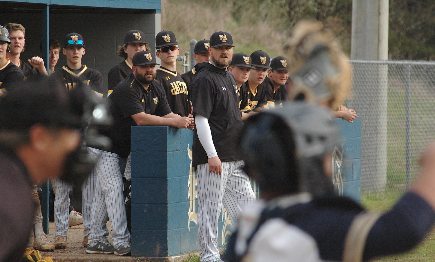 Corner coaches and players look on during an area game against Dora last week. Second-ranked Corner is off to a 14-1 start. Yellow Jacket head coach Josh Hoyle is hopeful the high school baseball season restarts in early April. The season was halted on March 16 due to the coronavirus pandemic.