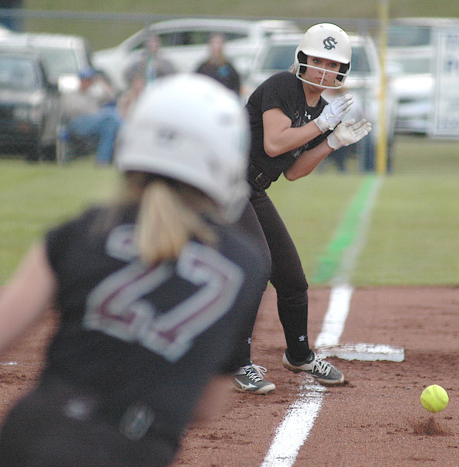 Sumiton Christian's Addy Russell pauses at third base before scoring on a hit by Gracie Ashley during Tuesday's 7-1 road win over Oakman.