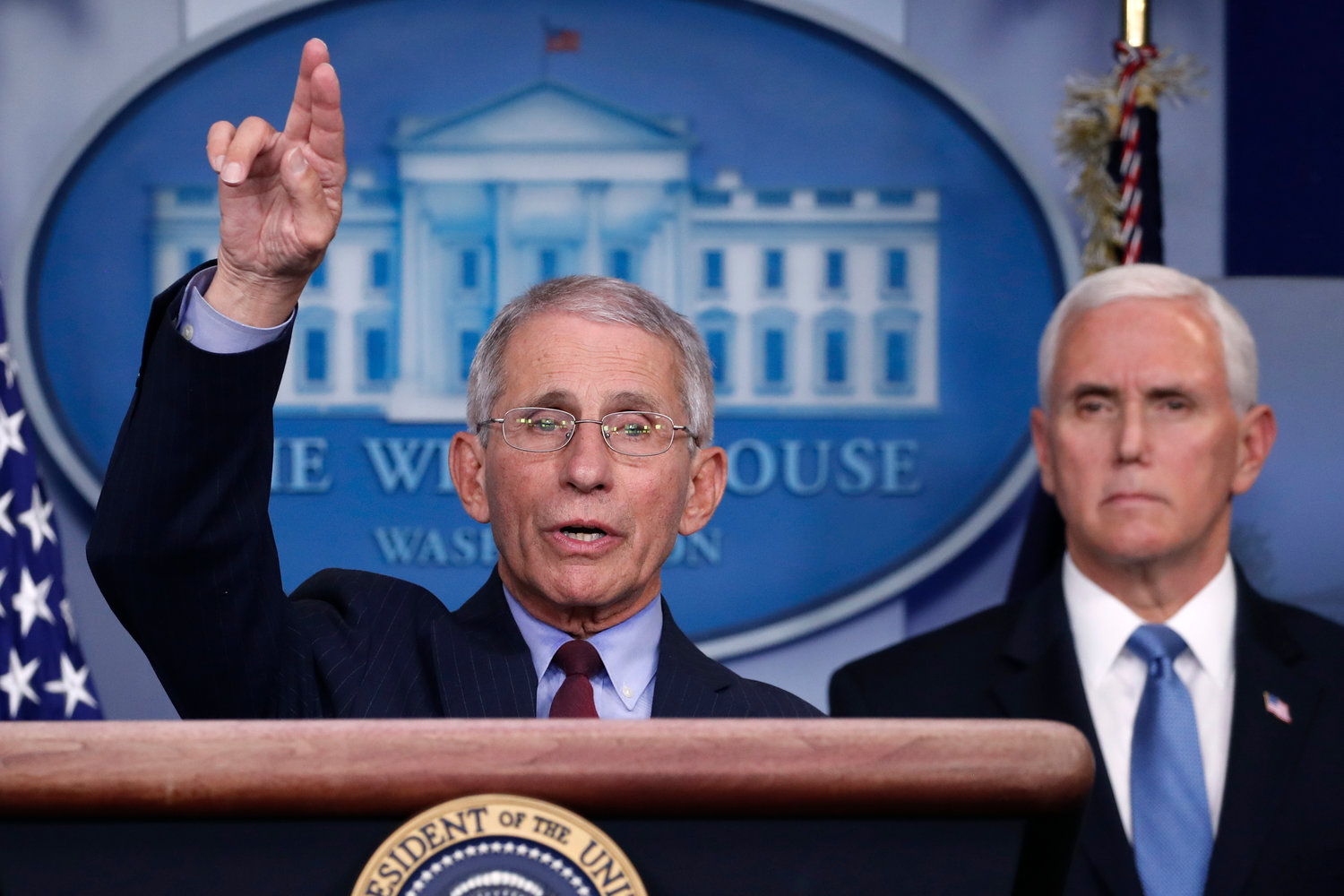 Dr. Anthony Fauci, director of the National Institute of Allergy and Infectious Diseases, speaks about the coronavirus in the James Brady Press Briefing Room of the White House, Tuesday, March 31, 2020, in Washington, as Vice President Mike Pence listens. (AP Photo/Alex Brandon)