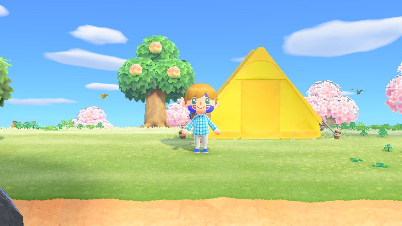 "An avatar wearing Chicago Cubs face paint stands in front of his tent in ""Animal Crossing: New Horizons."" Tents can quickly get upgraded to houses once the players pay off their debt."