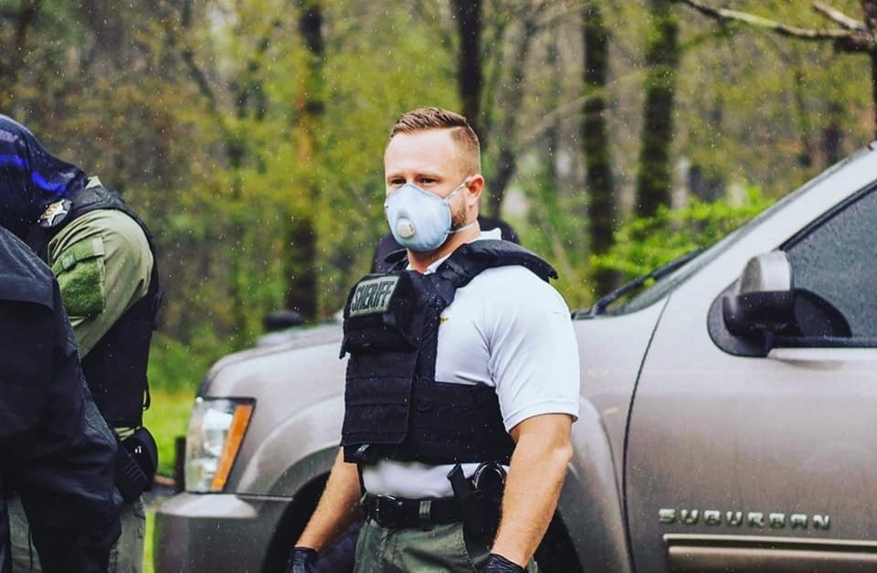 Sheriff Nick Smith wears a mask as drug search warrants were executed on March 23.