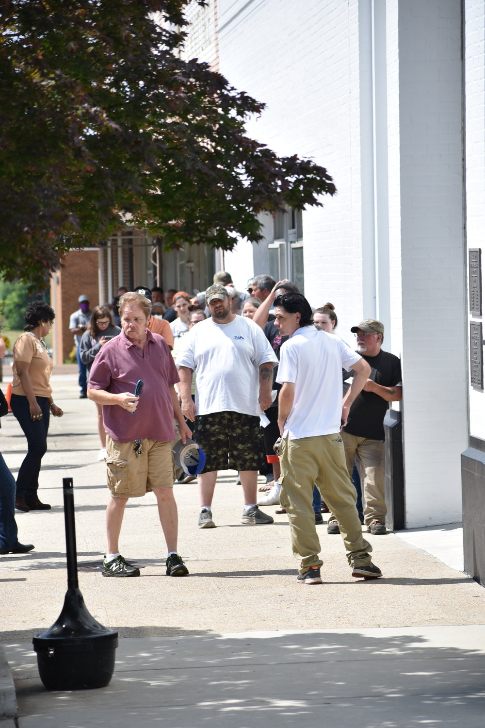 Long lines are seen outside the Walker County Probate Judge's Office Tuesday as the office reopened to the public Monday afternoon.