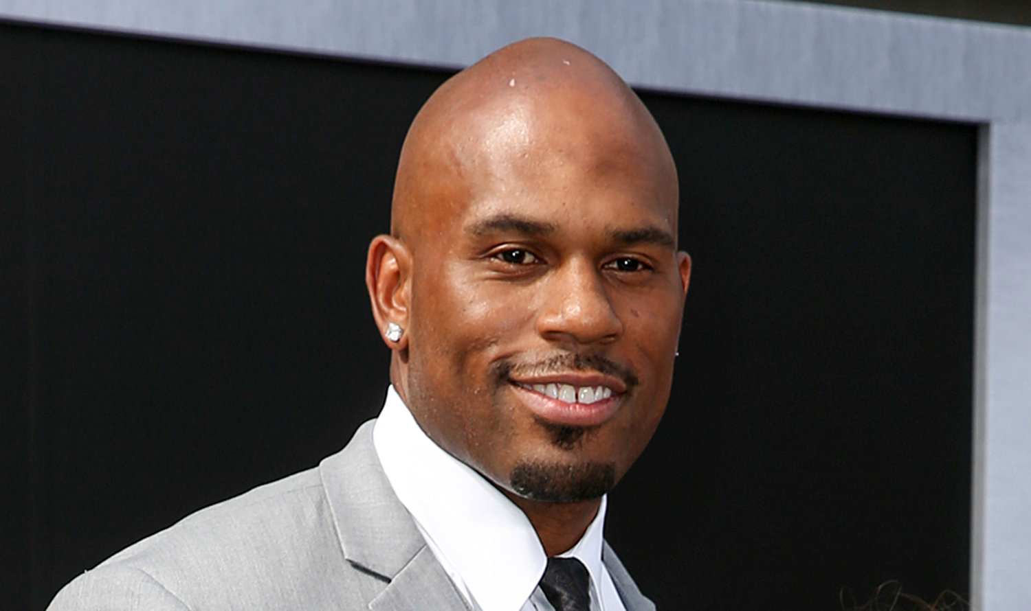 "FILE - In this June 28, 2015, file photo, WWE wrestler Shad Gaspard arriving at the Los Angeles premiere of ""Terminator Genisys"" at the Dolby Theatre in Los Angeles. The former World Wrestling Entertainment pro remained missing Tuesday, May 19, 2020 after being swept out to sea while swimming with his young son over the weekend off Southern California, police said. Gaspard's 10-year-old son Aryeh was rescued and several other swimmers made it out of the water safely after they were caught in a rip current Sunday afternoon at Venice Beach in Los Angeles. (Photo by Rich Fury/Invision/AP, File)"