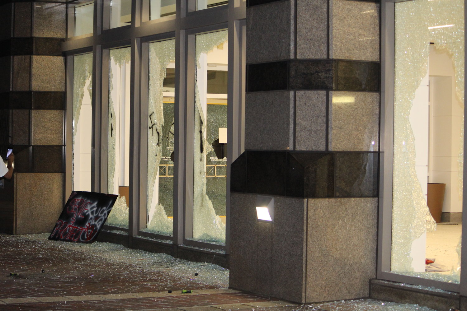 The windows of Wells Fargo on 6th Ave N in Birmingham were busted out as protests in the city turned violent. Multiple businesses were damaged, along with Confederate monuments in Lynn Park.