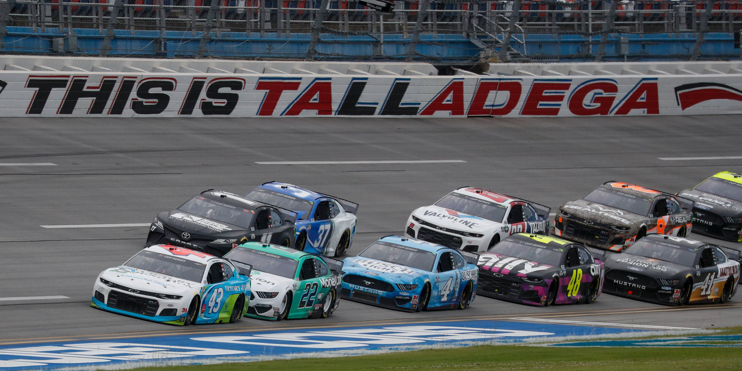 Monster Energy NASCAR Cup Series driver Bubba Wallace (43) leads the pack during a NASCAR Cup Series auto race at Talladega Superspeedway in Talladega Ala., Monday, June 22, 2020. (AP Photo/John Bazemore)