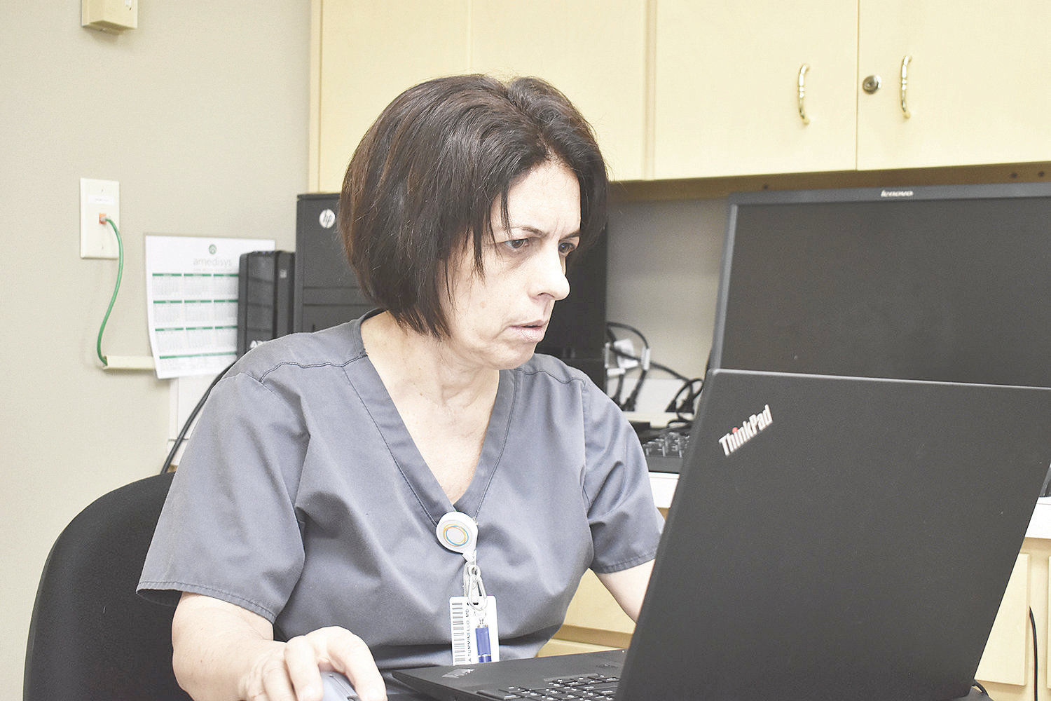 Dr. Paola Tumminello works in her office at Walker Baptist Medical Center.