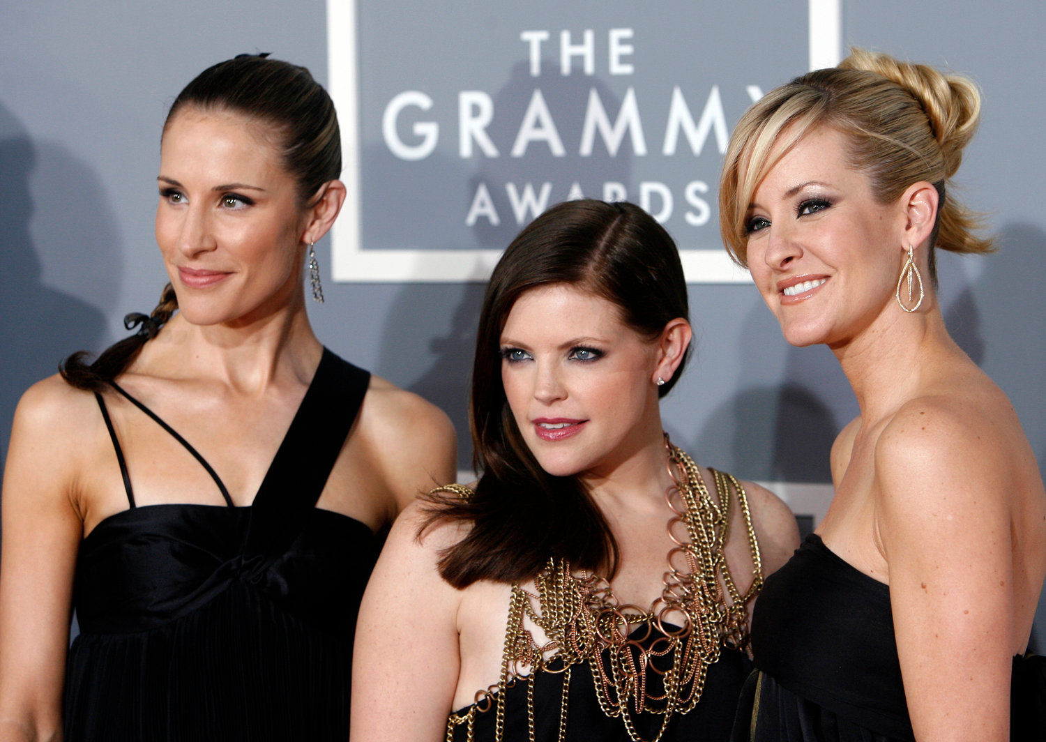In this Feb. 11, 2007 file photo, the Dixie Chicks, Emily Robison, left, Natalie Maines, center, and Martie Maguire arrive for the 49th Annual Grammy Awards in Los Angeles. The Grammy-winning country group have dropped the word dixie from their name and are now going by The Chicks. The move follows a decision by country group Lady Antebellum to change to Lady A after acknowledging the word's association to slavery. (AP Photo/Matt Sayles, File)