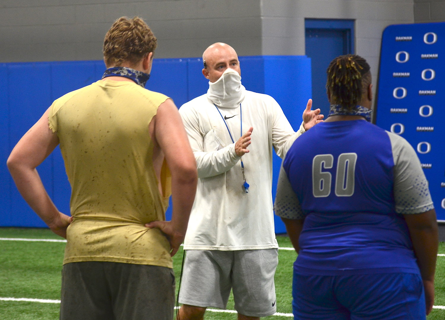 Oakman football coach Ryan Hall talks to players in the indoor practice facility during a practice this week. Hall is beginning his second season as the Wildcats' head coach. Oakman is scheduled to start the season at home on Aug. 21 against Gordo.