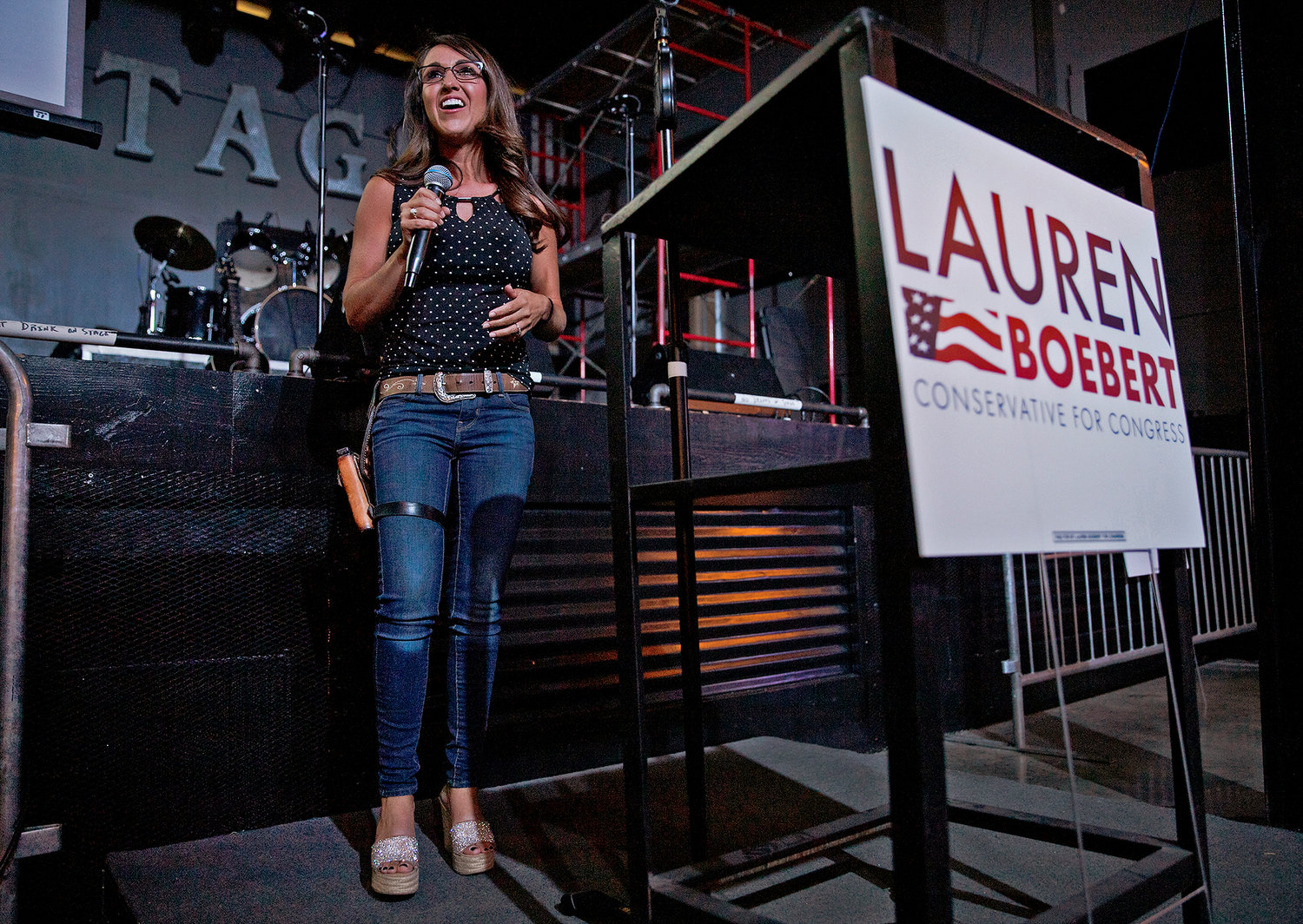 Businesswoman Lauren Boebert speaks during a watch party at Warehouse 25 Sixty Five in Grand Junction, Colo., after polls closed in Colorado's primary election on Tuesday, June 30, 2020. Boebert, a pistol-packing restaurant owner who has expressed support for a far-right conspiracy theory has upset five-term Colorado U.S. Rep. Scott Tipton. Lauren Boebert is an ardent defender of gun rights and border wall supporter. She will run in November's general election against Diane Mitsch Bush, who won the Democratic nomination on Tuesday.  (McKenzie Lange/Grand Junction Sentinel via AP, File)