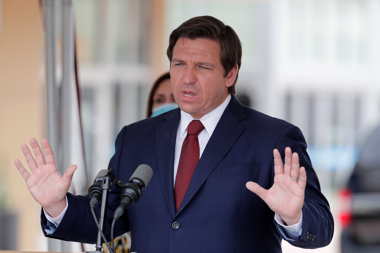 In this Thursday, May 14, 2020, file photo, Florida Gov. Ron DeSantis speaks at a news conference in Doral, Fla. A federal appellate court has stayed a lower court ruling that gave impoverished Florida felons the right to vote. The order issued Wednesday, July 1, 2020, disappointed voting rights activists and could have national implications in November's presidential election. In May, a federal judge ruled that Florida law can't stop disenfranchised felons from voting because they can't pay back any legal fees and restitution they owe. DeSantis immediately appealed to the Atlanta-based 11th U.S. Circuit Court of Appeals, requesting a stay of the ruling and a review of the case by the full appeals court. (AP Photo/Lynne Sladky, File)