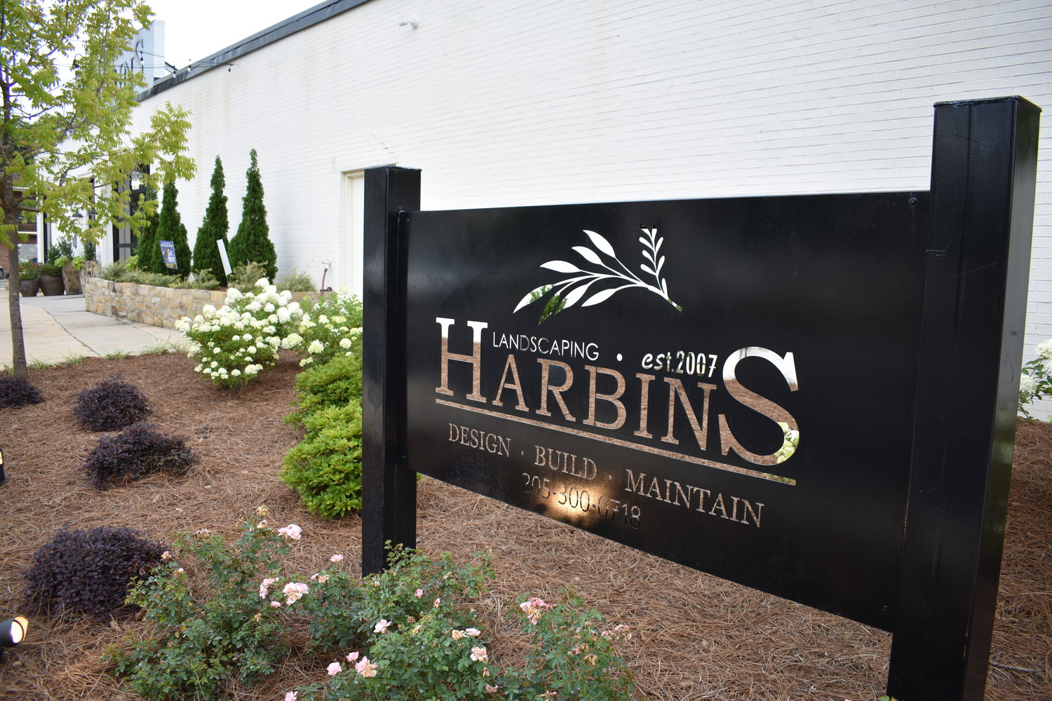 Harbin's Landscaping in Jasper is wanting to tear down the old 1920s house across the intersection to expand, noting the old home is not structurally sound to be used.