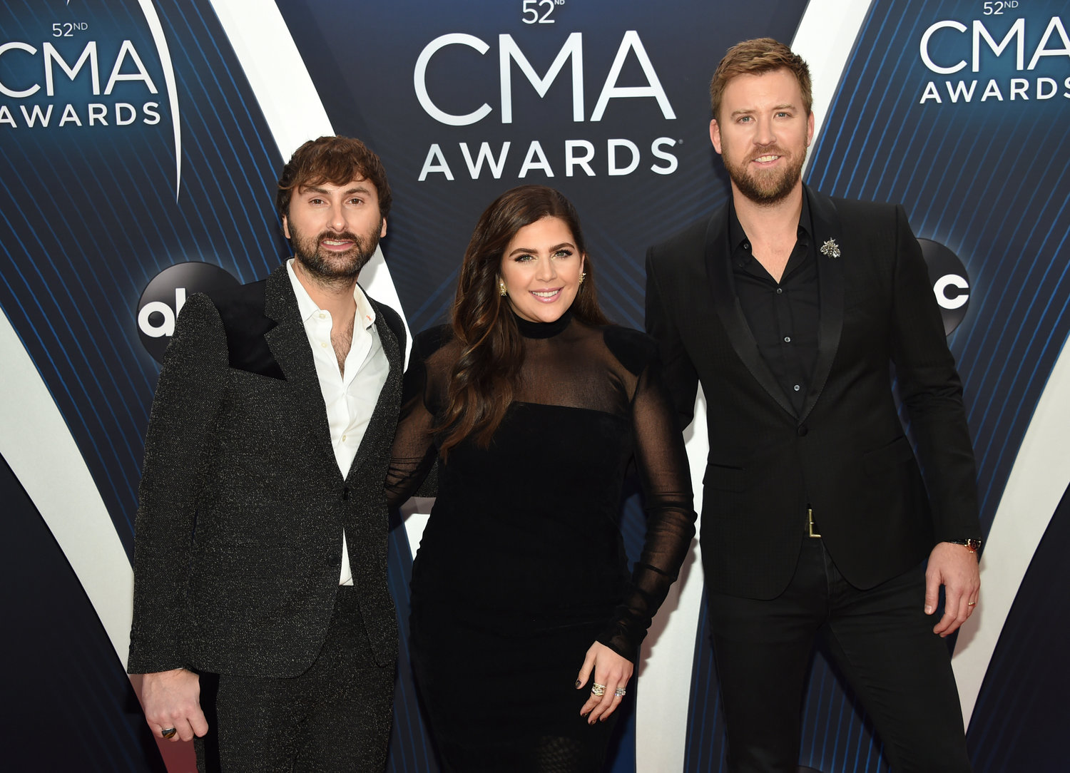 "In this Nov. 14, 2018 file photo, Dave Haywood, from left, Hillary Scott and Charles Kelley, of Lady A, formerly Lady Antebellum, arrive at the 52nd annual CMA Awards in Nashville, Tenn. The Grammy-winning country group, which dropped the word ""Antebellum"" from their name because of the word's ties to slavery, has filed a lawsuit against a Black singer who has used the stage name for years. The vocal group filed the lawsuit on Wednesday in federal court in Nashville after negotiations with Anita White broke down in recent weeks. (Photo by Evan Agostini/Invision/AP, File)"