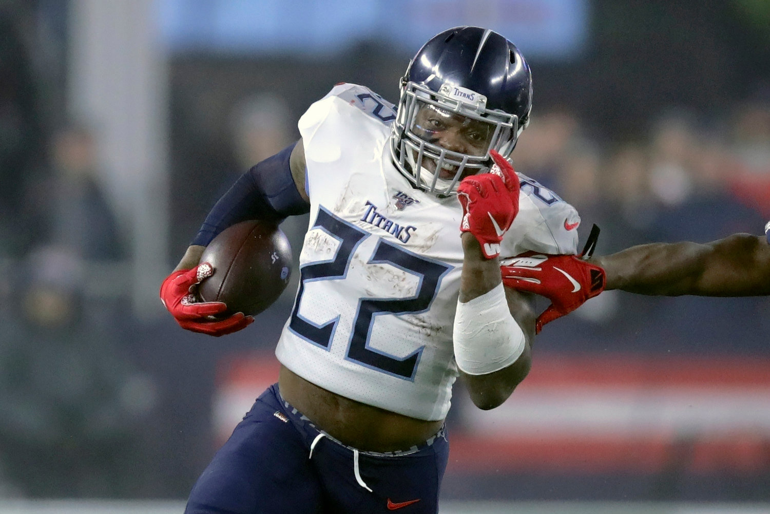 Tennessee Titans running back Derrick Henry runs from New England Patriots safety Duron Harmon, right, in the first half of an NFL wild-card playoff football game, Saturday, Jan. 4, 2020, in Foxborough, Mass. (AP Photo/Charles Krupa)