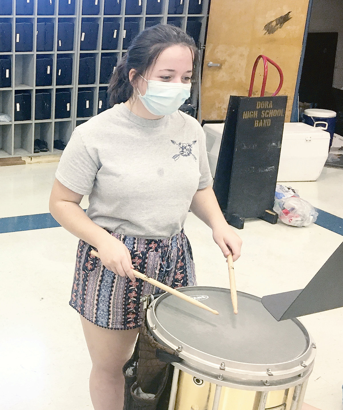 A Dora High School student wears a face mask to help prevent the spread of COVID-19 during band camp.