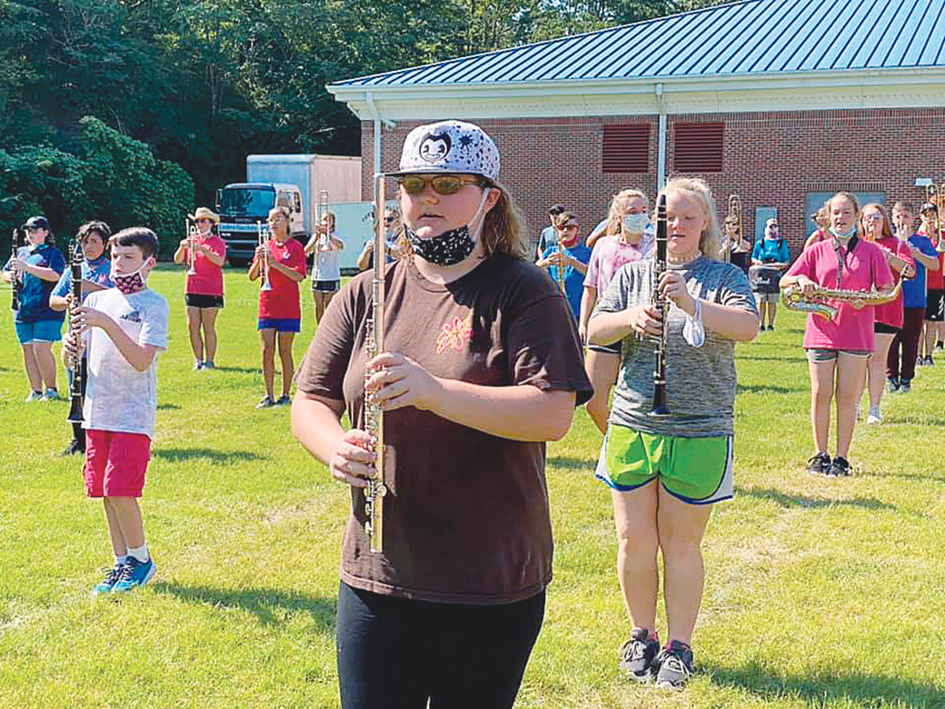 Cordova High School band students have been required to wear face masks during practice but are allowed to lower their masks during socially distanced outdoor activity.
