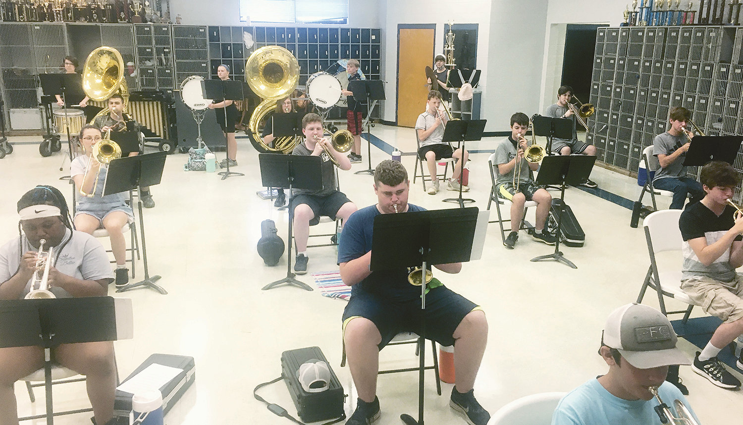 Band students are pictured 6 feet apart during practice at Dora High School.