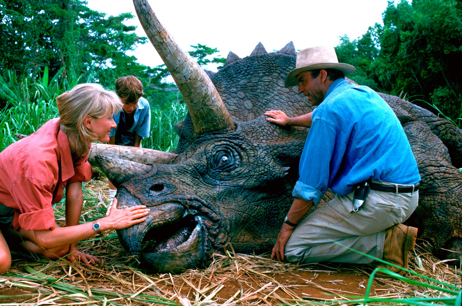 "This image released by Universal Pictures shows, from left, Laura Dern, Joseph Mazzello and Sam Neill in a scene from the 1993 film ""Jurassic Park."" With all major new releases postponed until at least Labor Day weekend due to the pandemic, summer moviegoing has belonged to the classics. ""Jurassic Park"" has led them all with a bit more than $3 million in ticket sales this summer, according to several people who have seen box-office grosses. (Universal Pictures via AP)"
