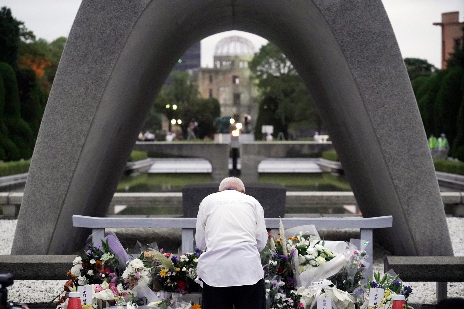 A man prays in front of the cenotaph for the atomic bombing victims before the start of ceremony to mark the 75th anniversary of the bombing in Hiroshima, western Japan early Thursday, Aug. 6, 2020. (AP Photo/Eugene Hoshiko)